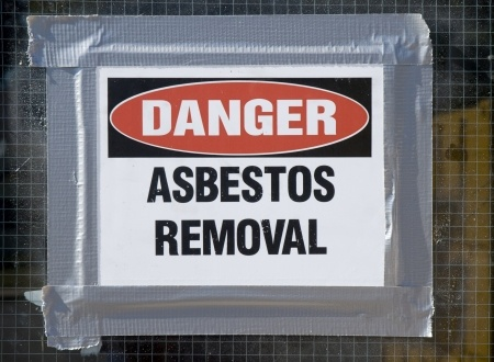 17857757 - danger asbestos removal sign posted on school window.